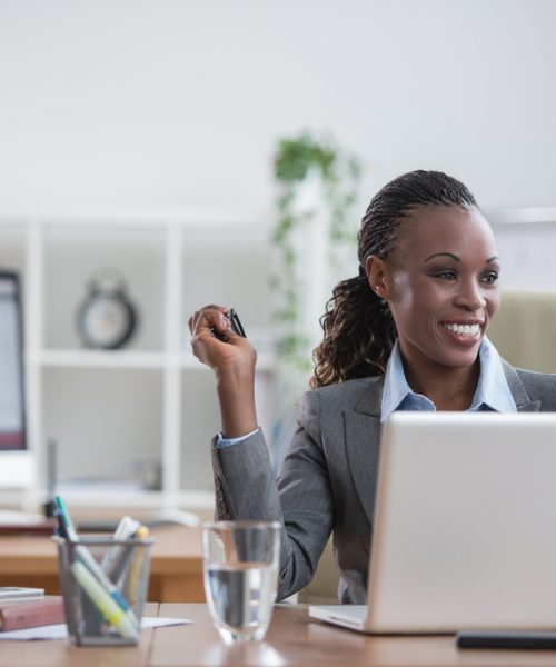 Pretty african business woman having fun at office